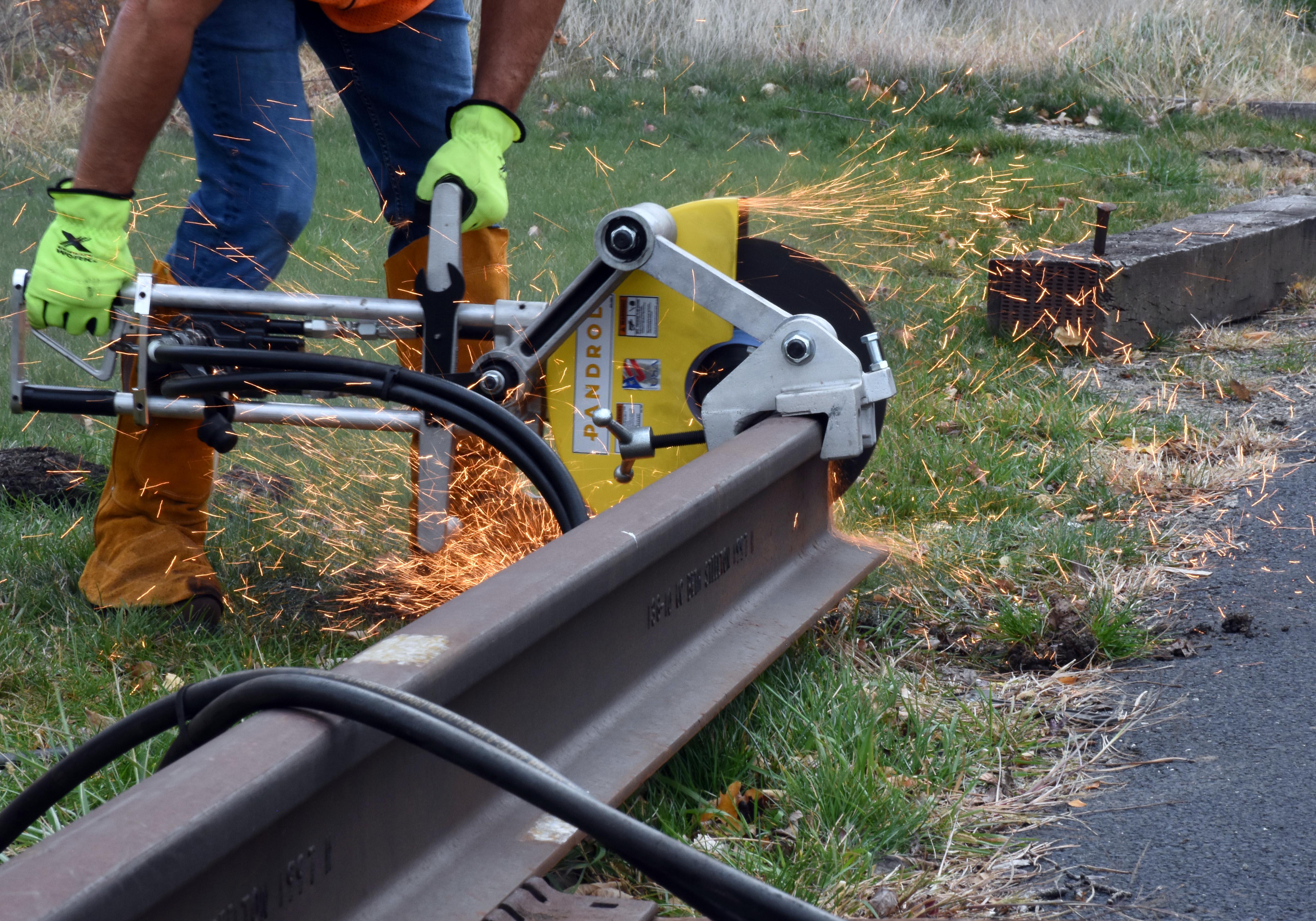 "Norton 14"" rail cut-off wheel loaded on Pandrol rail saw"